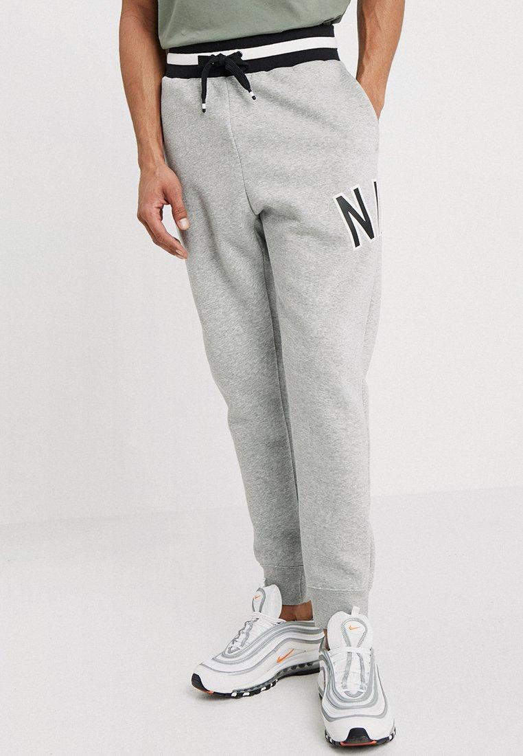 Nike Sportswear - AIR PANT - Spodnie treningowe - dark grey heather/black