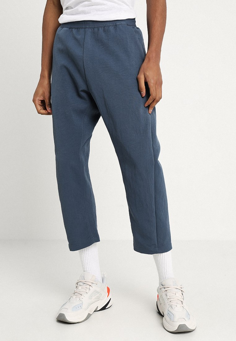 Nike Sportswear - PANT CROP - Tracksuit bottoms - monsoon blue/lt blue fury/black