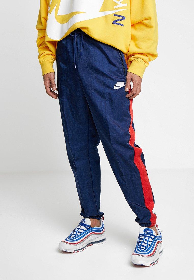 Nike Sportswear - PANT - Spodnie treningowe - blue void/university red