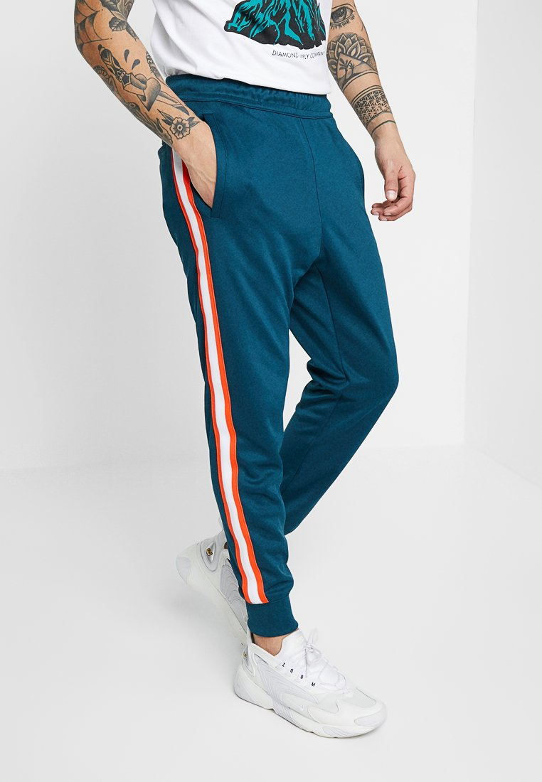 Nike Sportswear - TRIBUTE - Tracksuit bottoms - nightshade