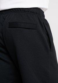 Nike Sportswear - CLUB - Spodnie treningowe - black - 4