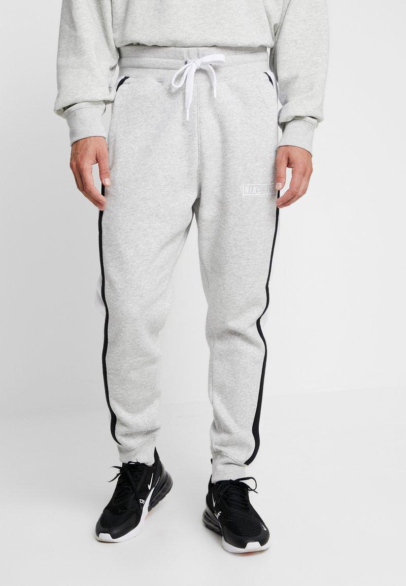 Nike Sportswear - AIR  - Jogginghose - grey heather/white/black