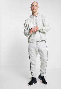 Nike Sportswear - AIR  - Trainingsbroek - grey heather/white/black - 1