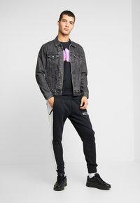 Nike Sportswear - AIR  - Pantalon de survêtement - black/white/grey heather - 1