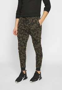 Nike Sportswear - Pantalon de survêtement - medium olive/black - 0