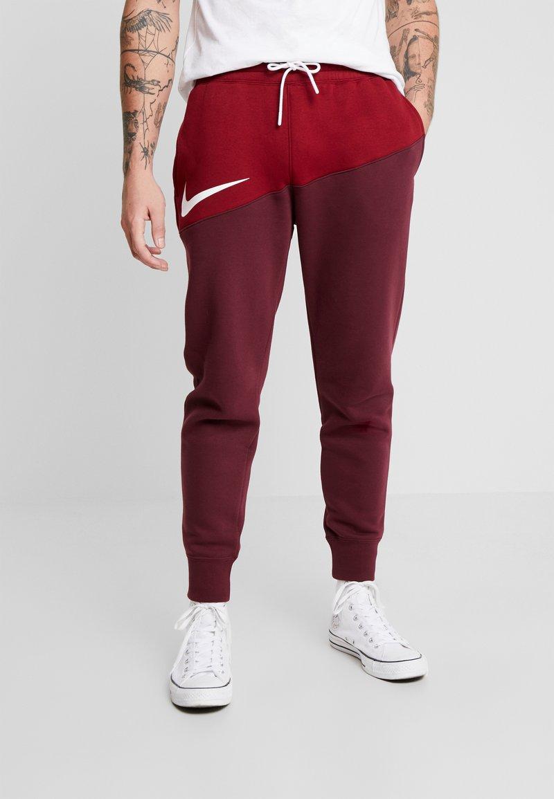 Nike Sportswear - Tracksuit bottoms - team red/night maroon/white