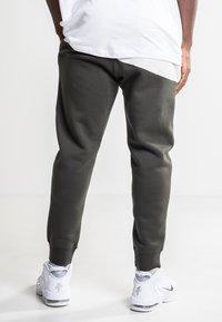 Nike Sportswear - Tracksuit bottoms - olive - 2