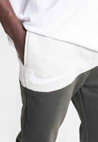 Nike Sportswear - Tracksuit bottoms - olive - 3