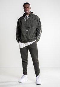 Nike Sportswear - Tracksuit bottoms - olive - 1