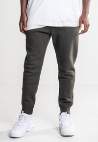 Nike Sportswear - Tracksuit bottoms - olive - 0