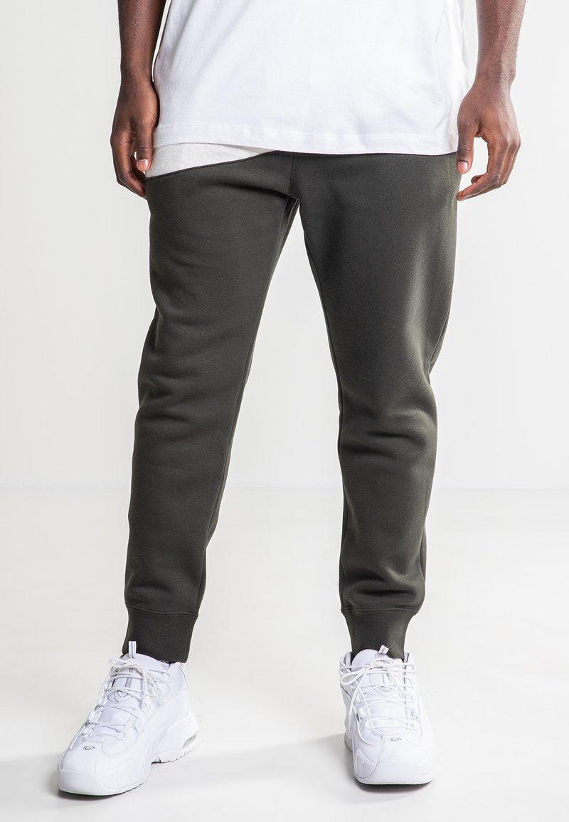 Nike Sportswear - Tracksuit bottoms - olive