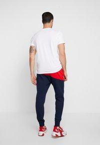 Nike Sportswear - PANT  - Träningsbyxor - university red/obsidian/white - 2