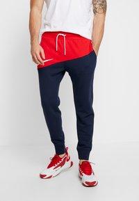 Nike Sportswear - PANT  - Träningsbyxor - university red/obsidian/white - 0