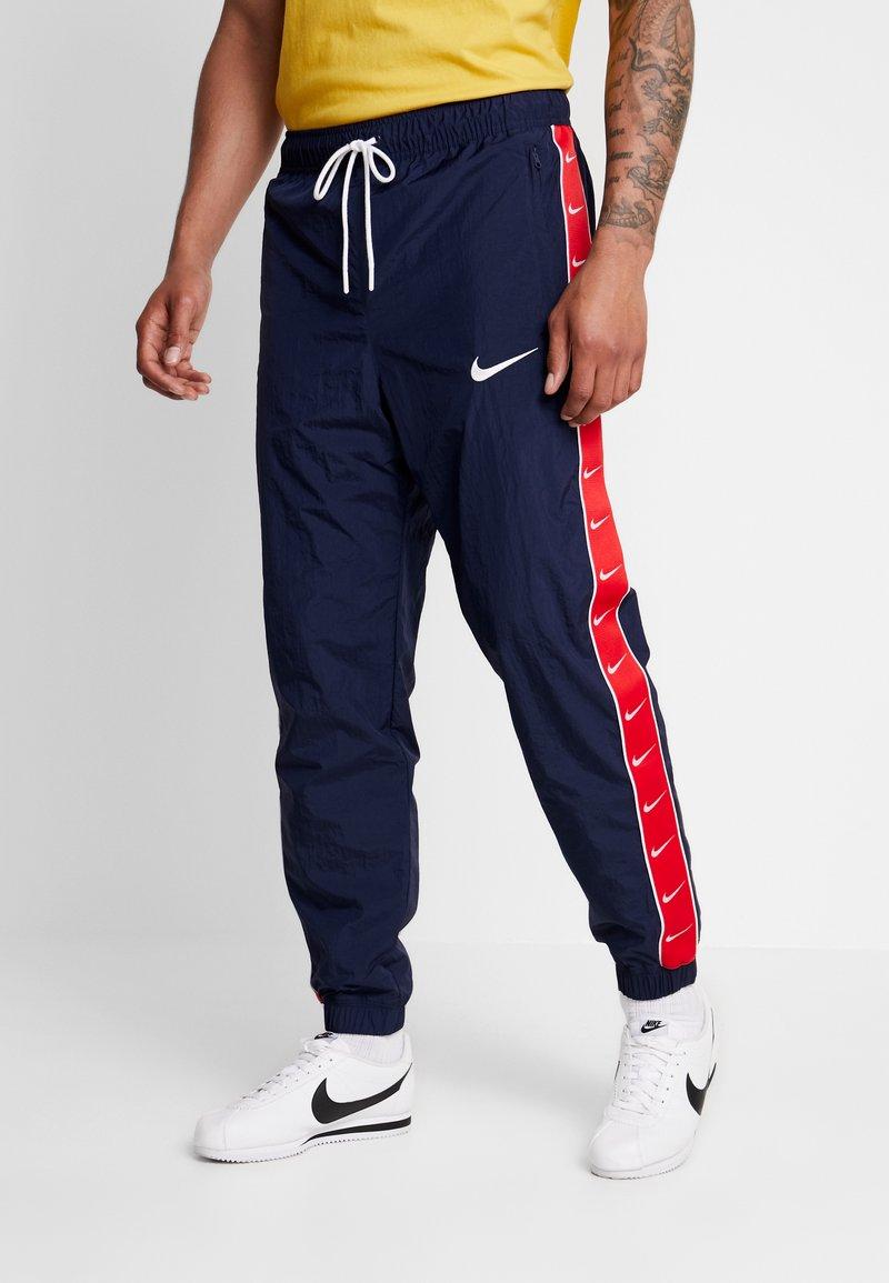 Nike Sportswear - PANT - Tracksuit bottoms - obsidian/university red