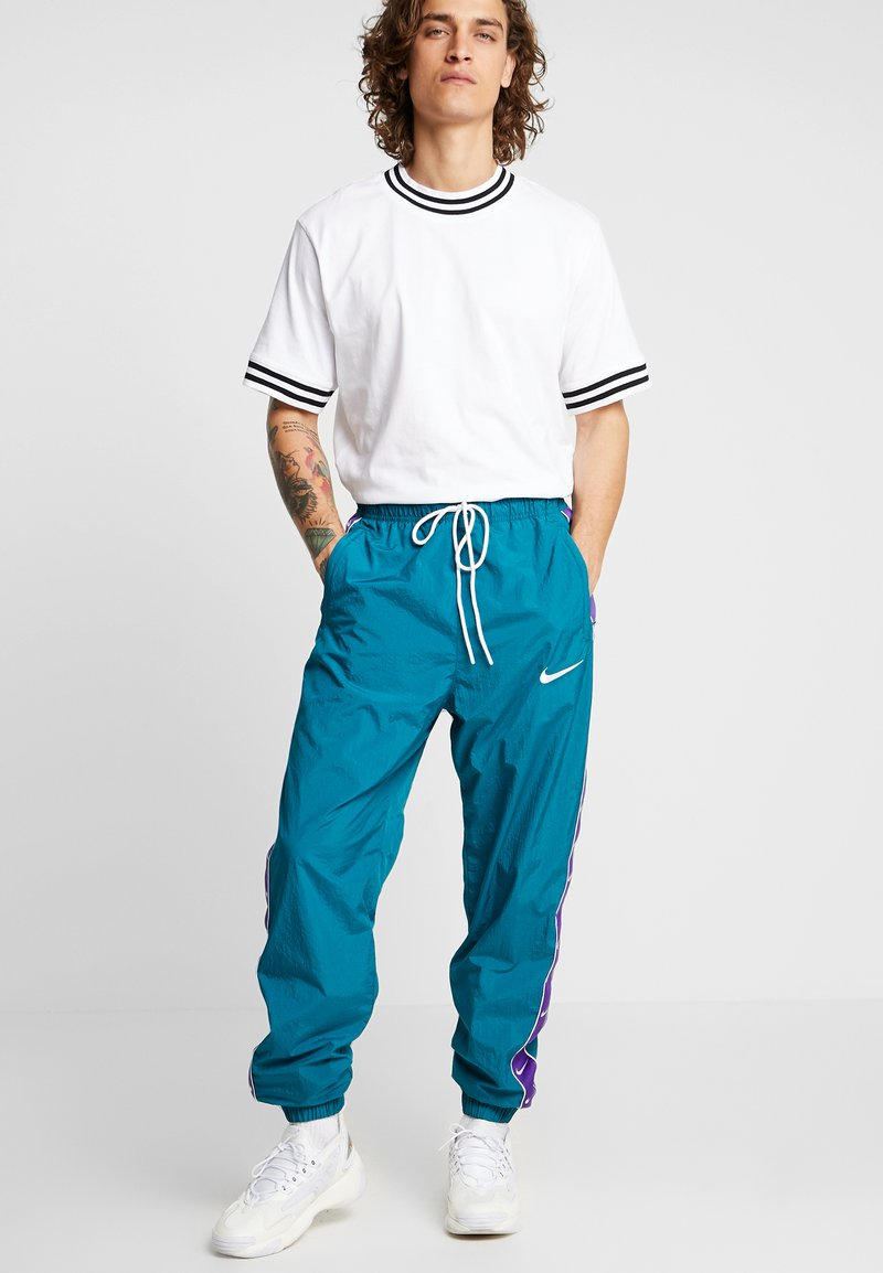 Nike Sportswear - PANT - Tracksuit bottoms - geode teal/court purple/white