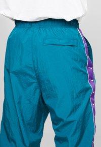 Nike Sportswear - PANT - Trainingsbroek - geode teal/court purple/white - 3