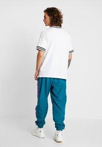 Nike Sportswear - PANT - Trainingsbroek - geode teal/court purple/white - 2