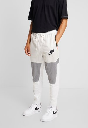 PANT BODYMAP - Verryttelyhousut - light bone/summit white/black