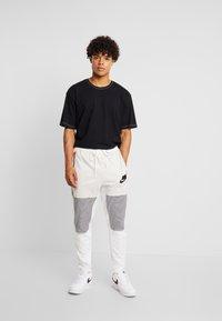 Nike Sportswear - PANT BODYMAP - Træningsbukser - light bone/summit white/black - 1