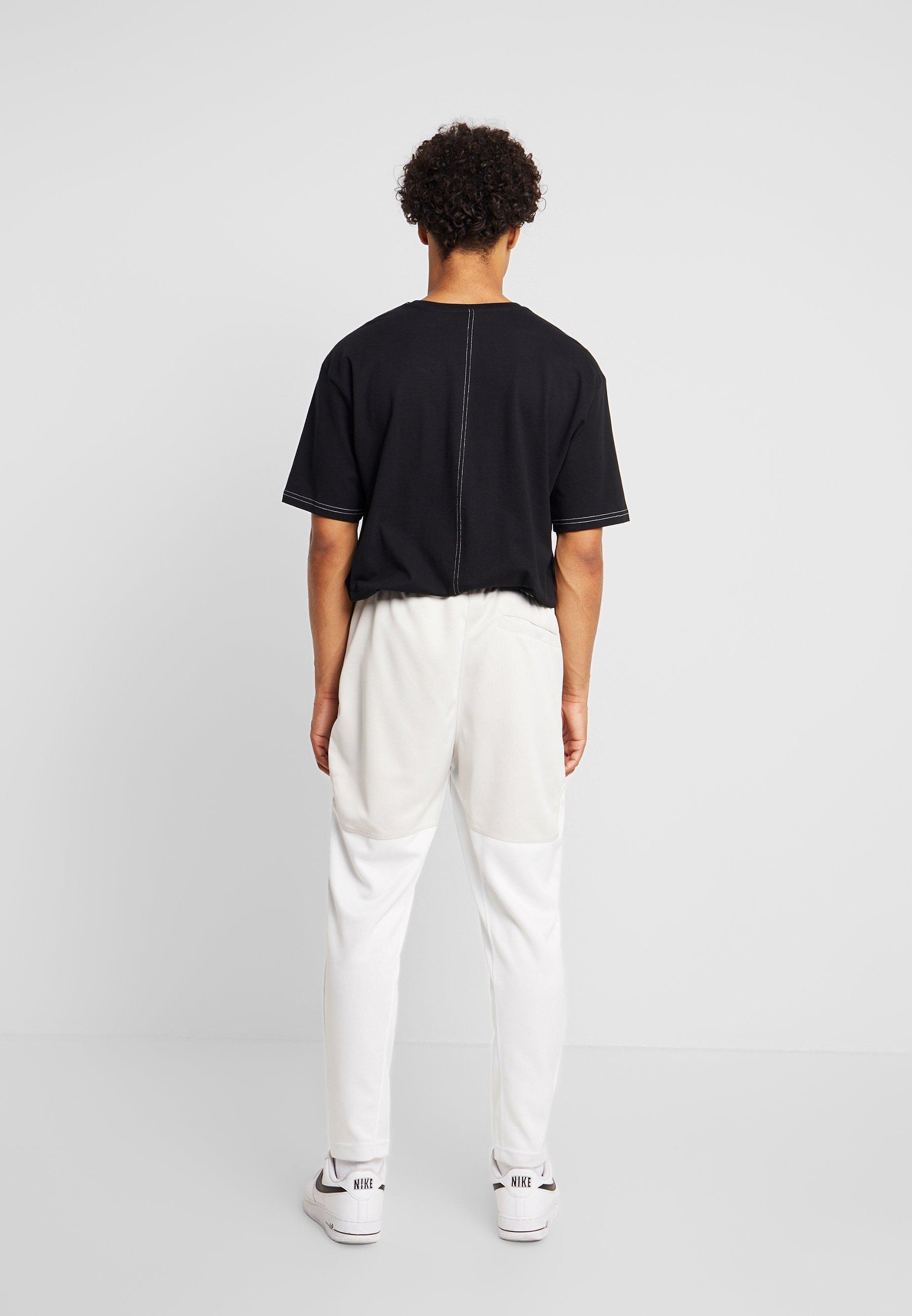 Nike Sportswear PANT BODYMAP - Spodnie treningowe - light bone/summit white/black