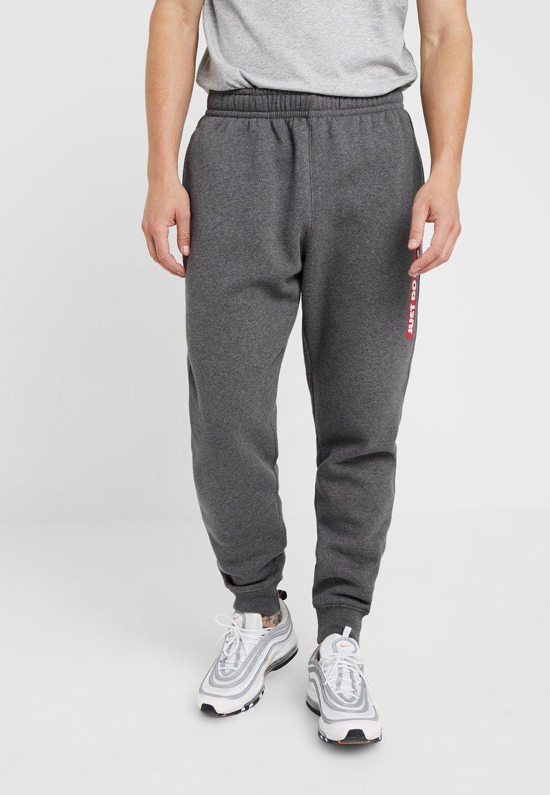 Nike Sportswear - Pantalones deportivos - charcoal heather
