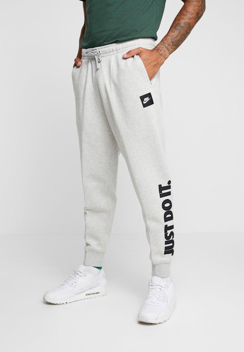 Nike Sportswear - PANT - Tracksuit bottoms - grey heather/black