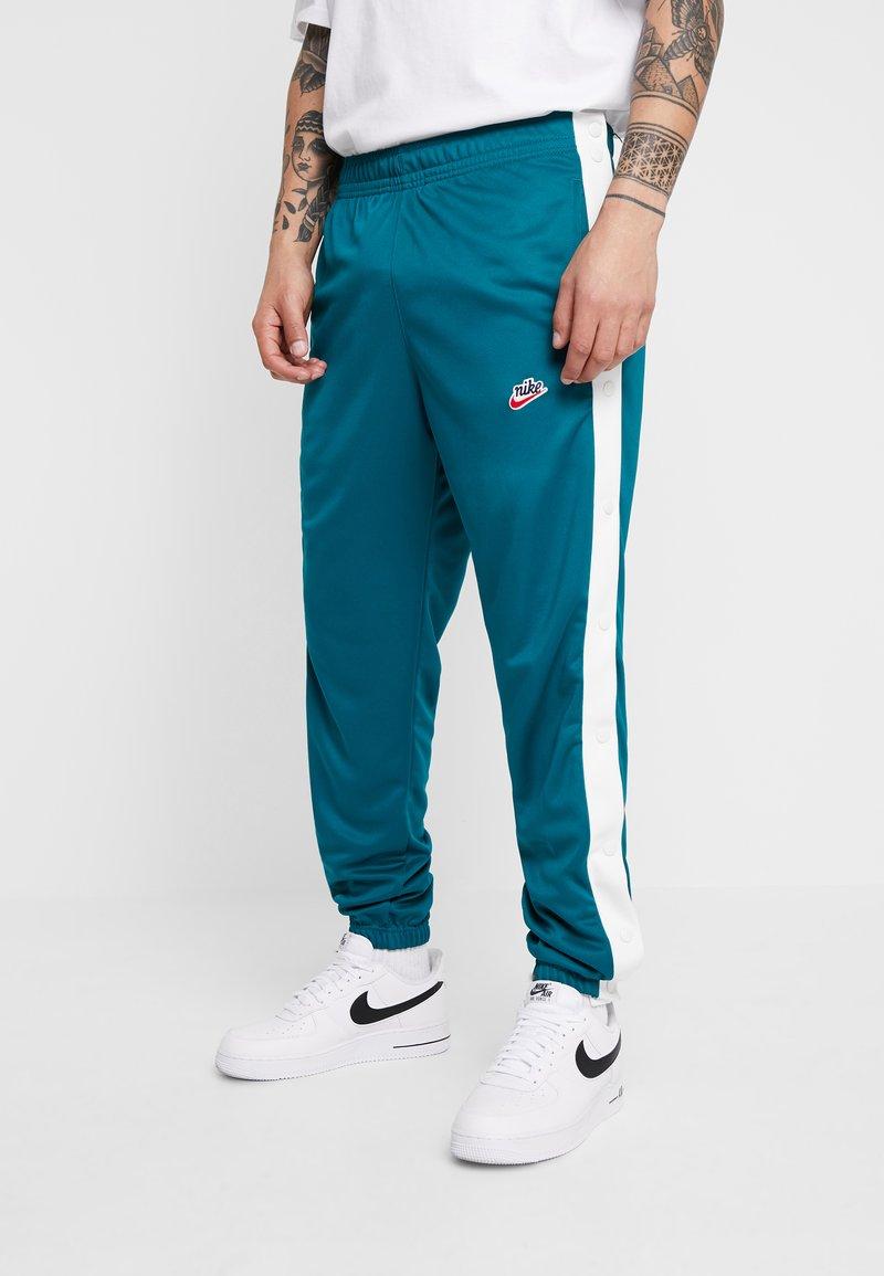 Nike Sportswear - TEARAWAY  - Tracksuit bottoms - geode teal/sail