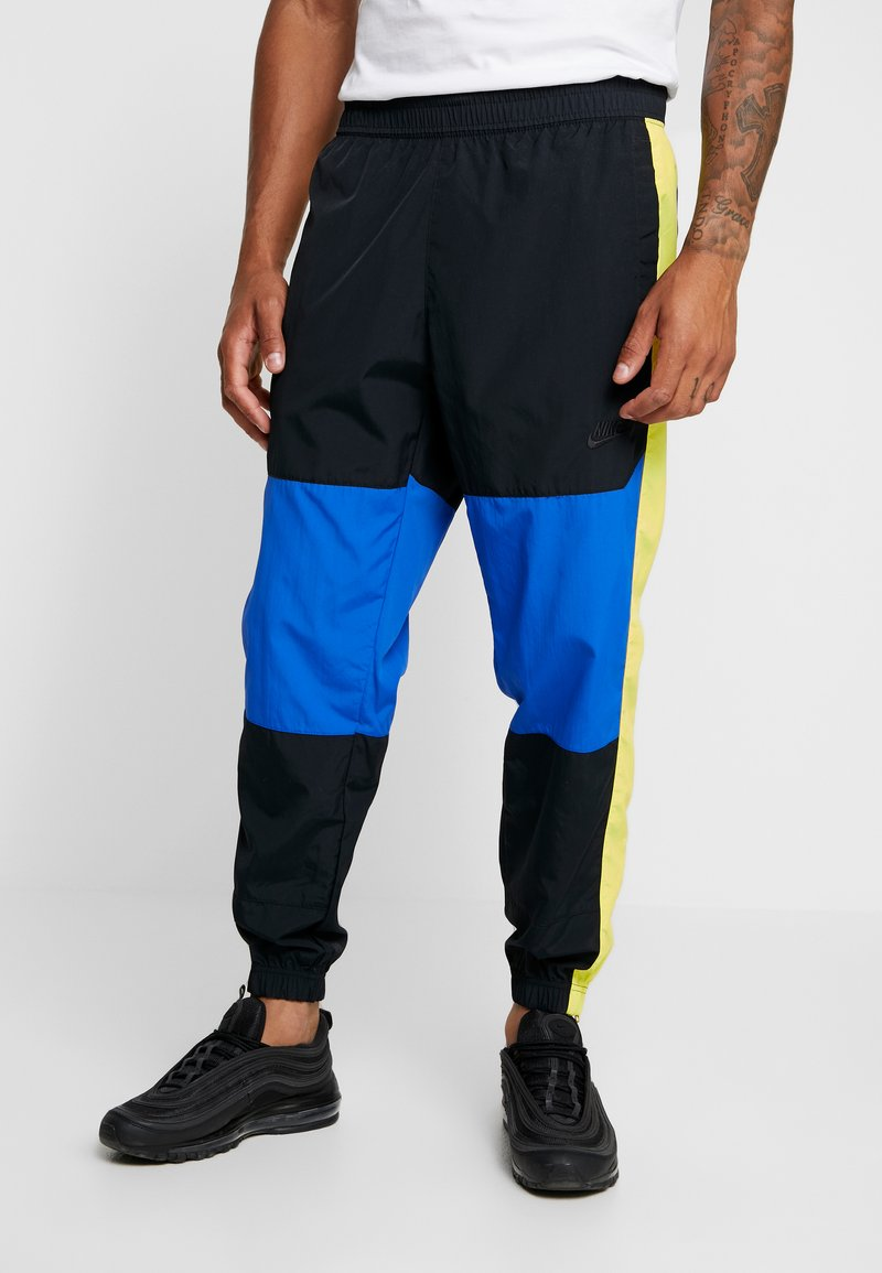 Nike Sportswear - ISSUE PANT - Tracksuit bottoms - black/midnight navy/volt glow