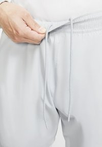 Nike Sportswear - ISSUE PANT - Tracksuit bottoms - pure platinum/white/sail - 2
