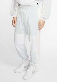 Nike Sportswear - ISSUE PANT - Tracksuit bottoms - pure platinum/white/sail - 0