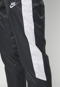 Nike Sportswear - Pantalon de survêtement - anthracite/vast grey/white - 3