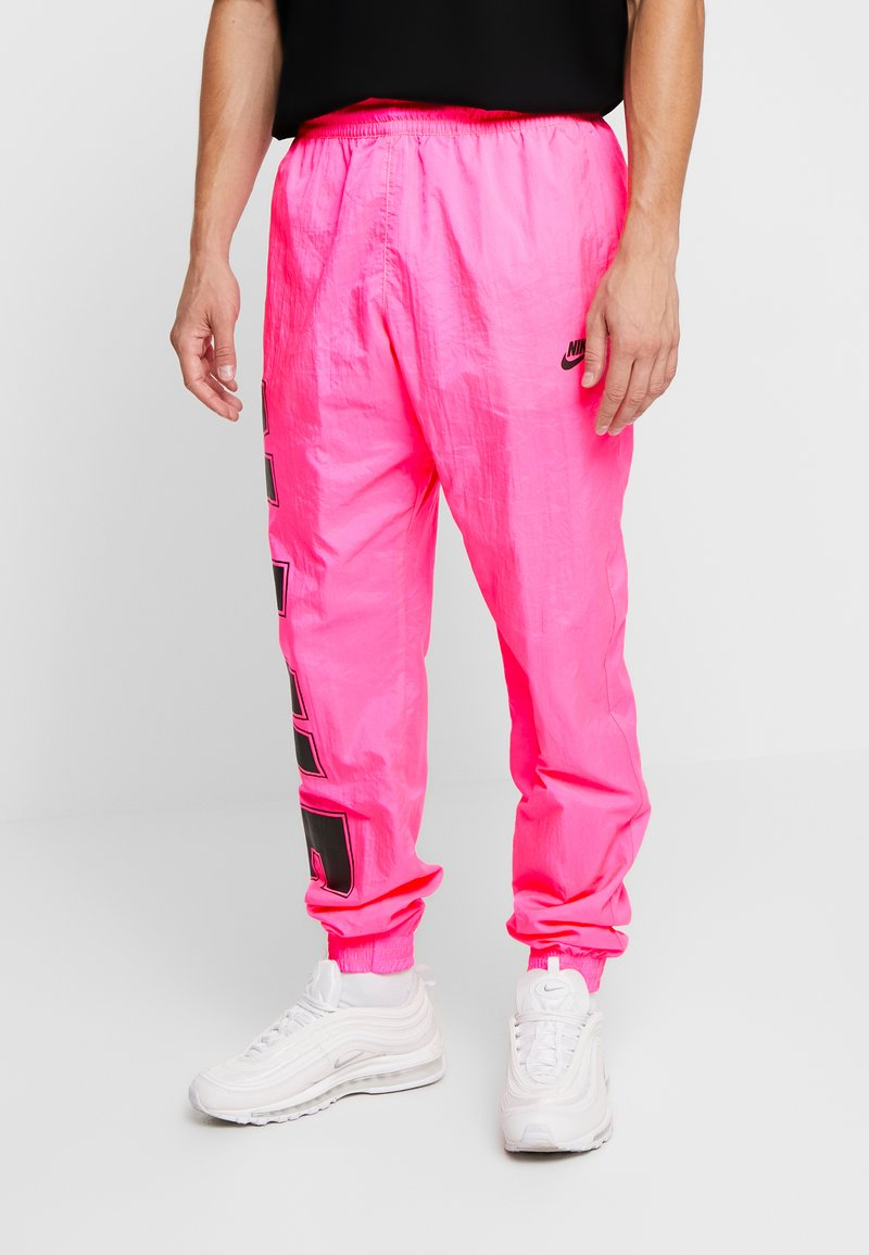 Nike Sportswear - WOVEN  - Tracksuit bottoms - hyper pink/black