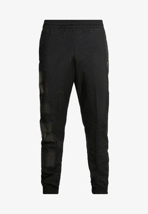 WOVEN  - Pantalon de survêtement - black