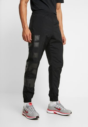 WOVEN  - Tracksuit bottoms - black