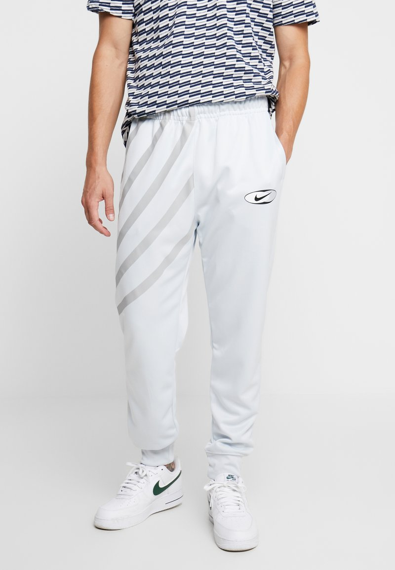 Nike Sportswear - SUBSET - Tracksuit bottoms - pure platinum
