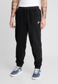 Nike Sportswear - PANT WINTER - Tracksuit bottoms - black/black/white - 0