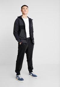 Nike Sportswear - PANT WINTER - Tracksuit bottoms - black/black/white - 1