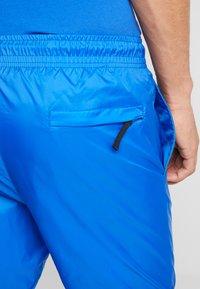 Nike Sportswear - PANT PATCH - Trainingsbroek - game royal - 5
