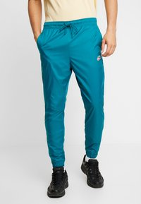 Nike Sportswear - PANT PATCH - Tracksuit bottoms - geode teal - 0