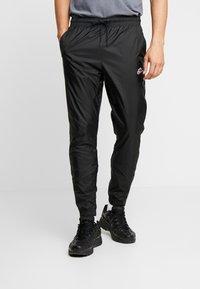 Nike Sportswear - PANT PATCH - Tracksuit bottoms - black - 0