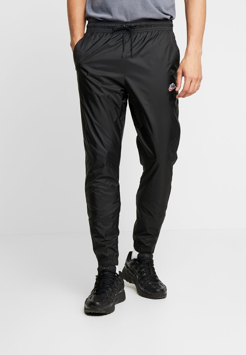 Nike Sportswear - PANT PATCH - Tracksuit bottoms - black