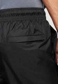 Nike Sportswear - PANT PATCH - Tracksuit bottoms - black - 5