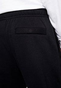 Nike Sportswear - METALLIC - Pantalones deportivos - black - 3