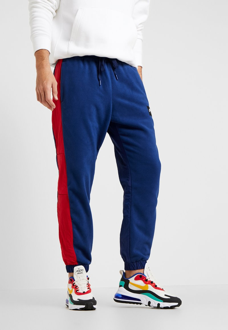 Nike Sportswear - AIR PANT MIX - Tracksuit bottoms - blue void/university red/white/black