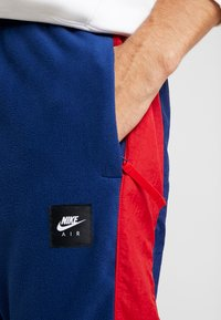 Nike Sportswear - AIR PANT MIX - Tracksuit bottoms - blue void/university red/white/black - 4