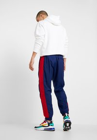 Nike Sportswear - AIR PANT MIX - Tracksuit bottoms - blue void/university red/white/black - 2