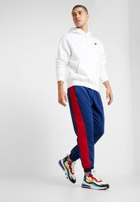 Nike Sportswear - AIR PANT MIX - Tracksuit bottoms - blue void/university red/white/black - 1