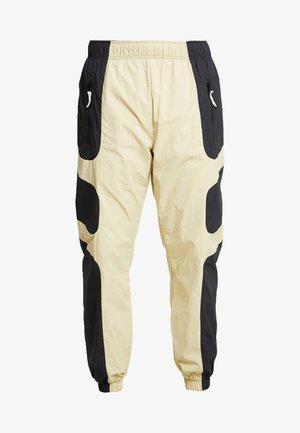 RE-ISSUE - Tracksuit bottoms - black/team gold