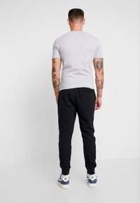 Nike Sportswear - PRNT AIR - Pantalon de survêtement - black - 2
