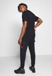 Nike Sportswear - PANT CARGO - Pantalon de survêtement - black - 2